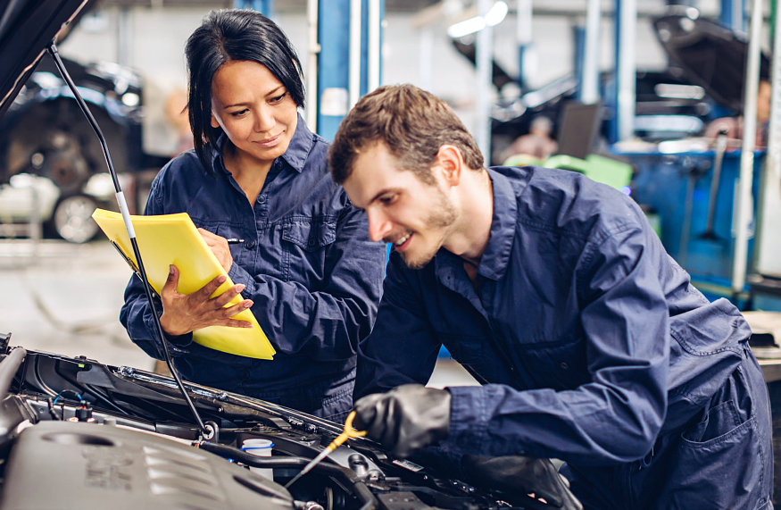 two mechanic are working together