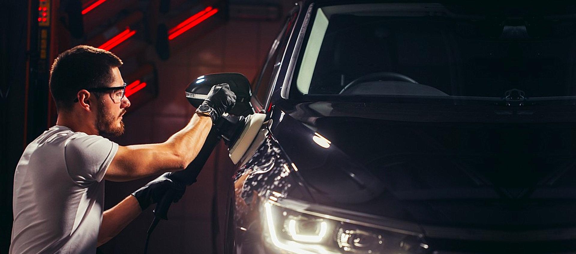 mechanic shining the car