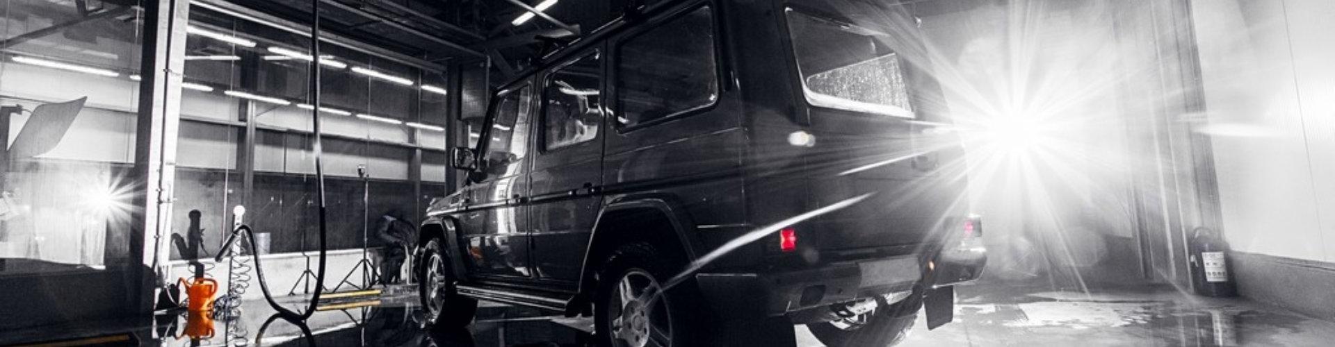 black SUV at the shop