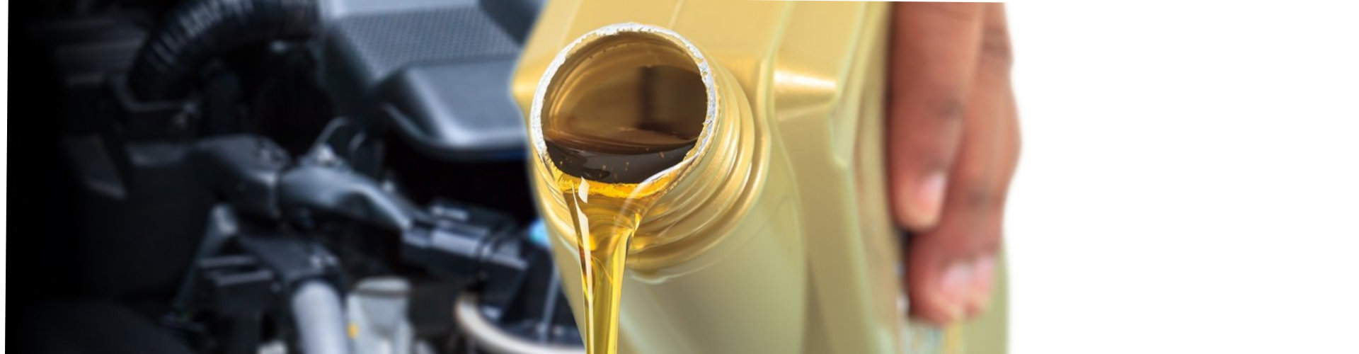 pouring oil lubricant motor car from bottle